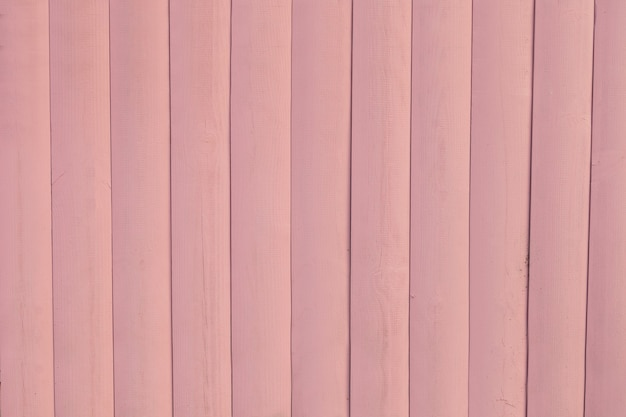 Painted light pink rustic wood board background. space for text- timber ground of painted plank. horizontal tinted photo.