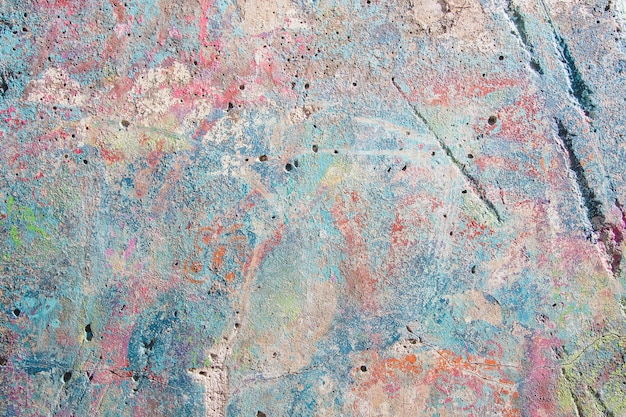 Painted in multi-colored concrete background
