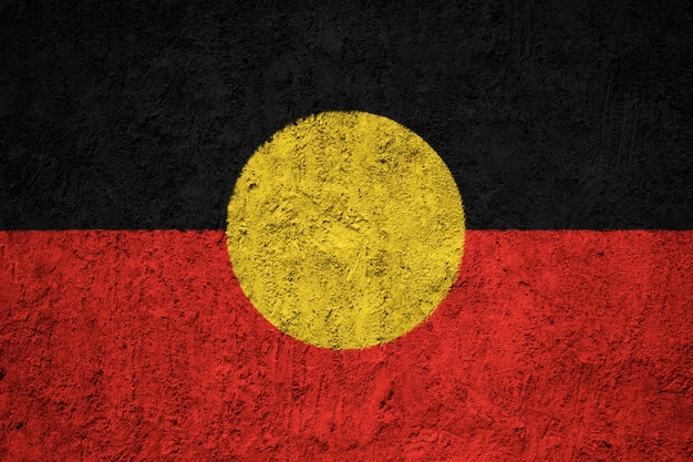 Painted national flag of australian aboriginal on a concrete wall