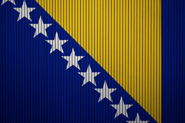 Painted national flag of bosnia and herzegovina on a concrete wall