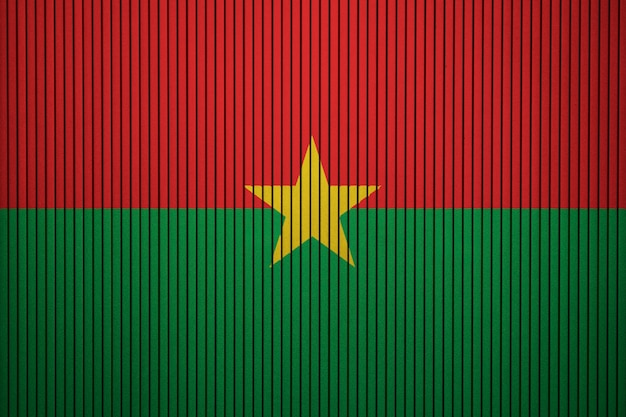 Painted national flag of burkina faso on a concrete wall