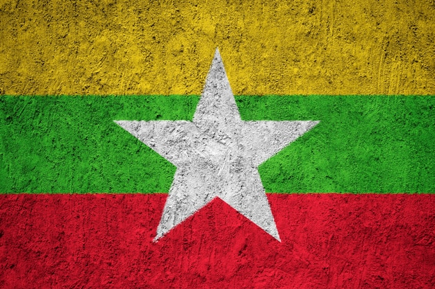 Painted national flag of burma / myanmar on a concrete wall