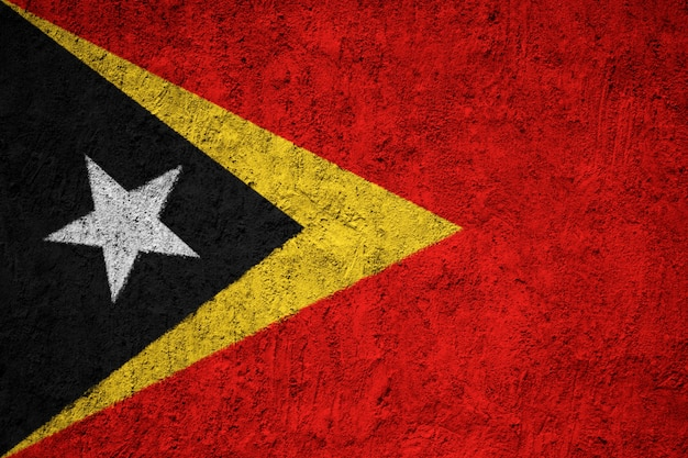 Painted national flag of east timor on a concrete wall