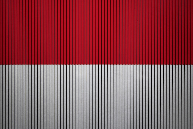 Painted national flag of indonesia on a concrete wall