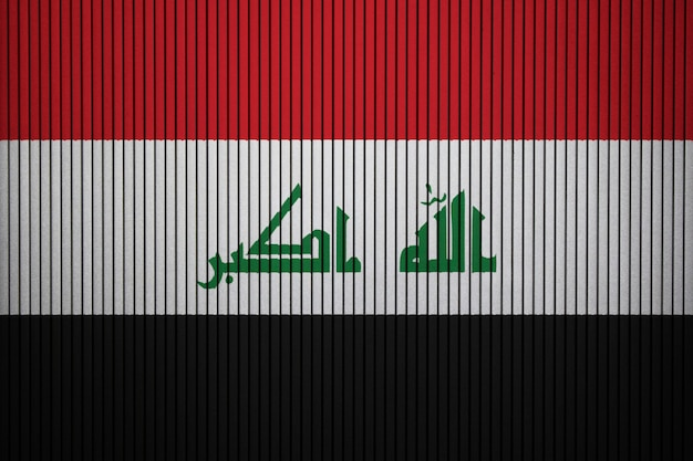 Painted national flag of iraq on a concrete wall