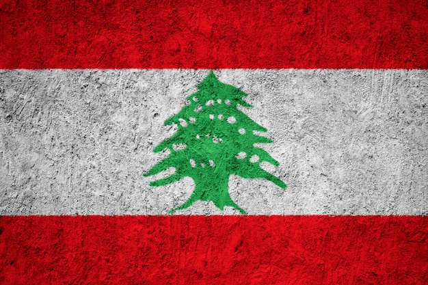 Painted national flag of lebanon on a concrete wall