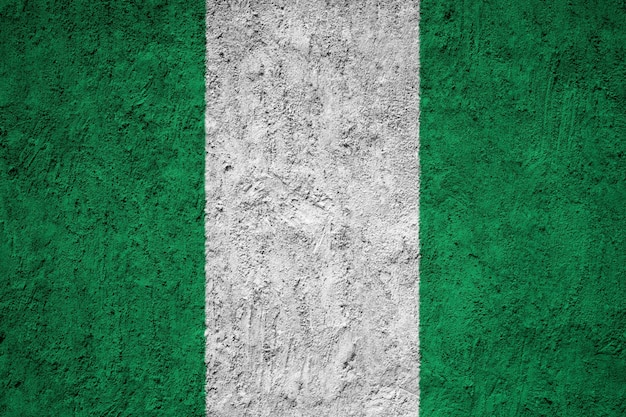 Painted national flag of nigeria on a concrete wall