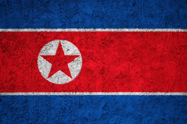 Painted national flag of north korea on a concrete wall