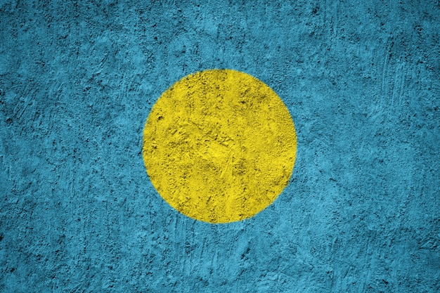 Painted national flag of palau on a concrete wall