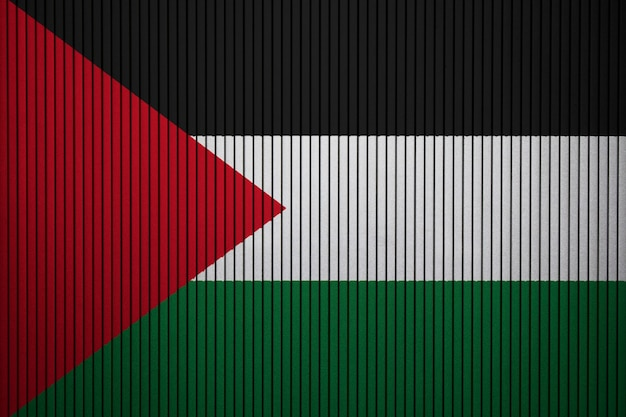 Painted national flag of palestine on a concrete wall