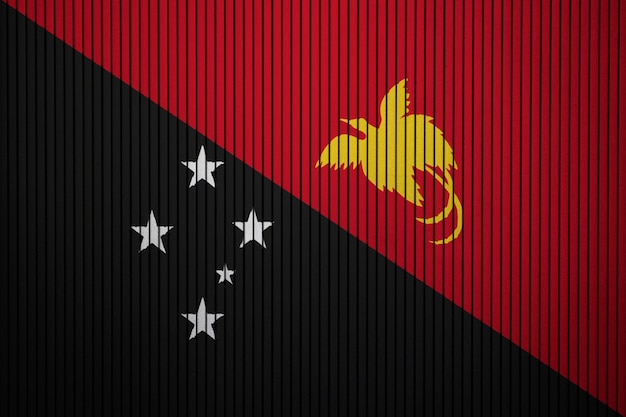 Painted national flag of papua new guinea on a concrete wall