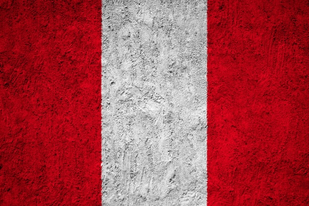 Painted national flag of peru on a concrete wall
