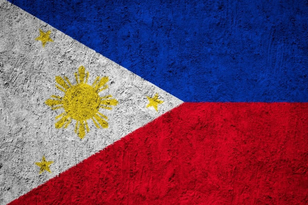 Painted national flag of philippines on a concrete wall