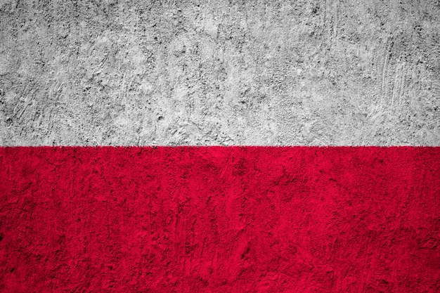 Painted national flag of poland on a concrete wall