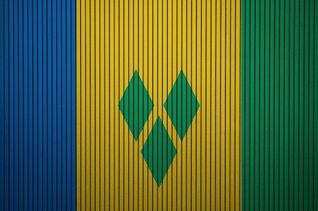 Painted national flag of saint vincent and the grenadines on a concrete wall