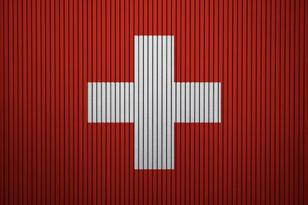 Painted national flag of switzerland on a concrete wall