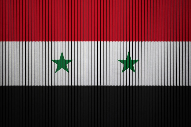 Painted national flag of syria on a concrete wall