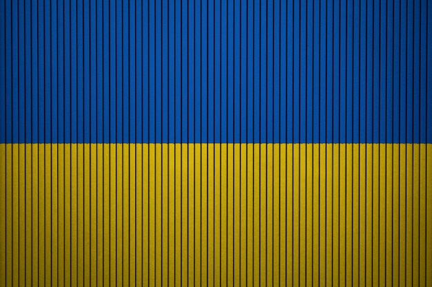 Painted national flag of ukraine on a concrete wall