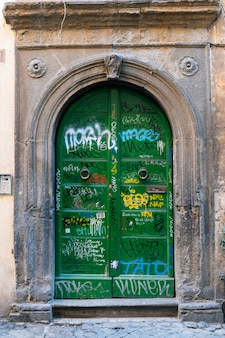 Painted old green door in ancient neighbourhood