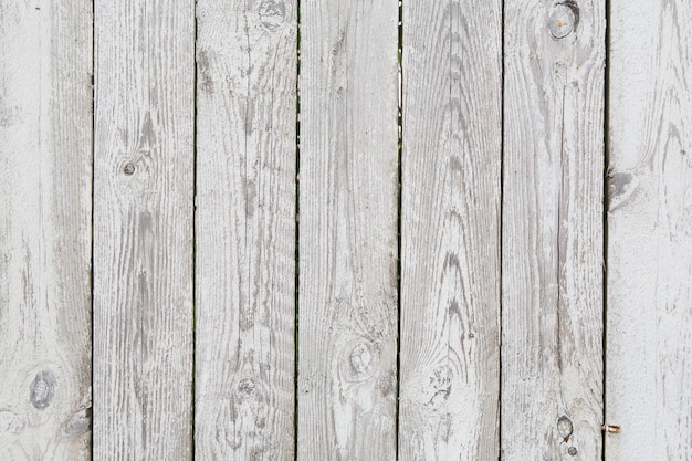 Painted old tacky grey wooden fence