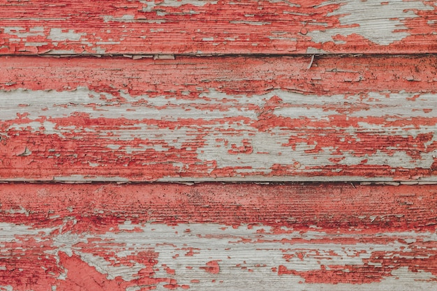 Painted old wooden red wall background.