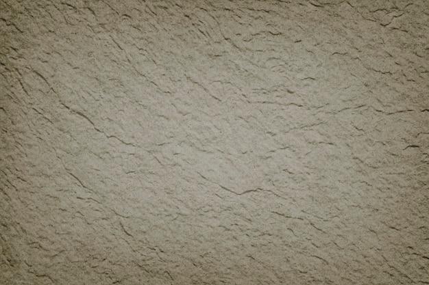 Окрашенная массивная бетонная стена с текстурированным фоном