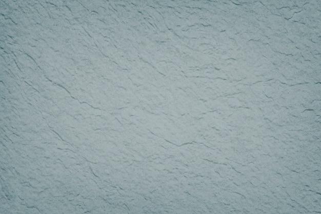 Contesto strutturato del muro di cemento solido dipinto