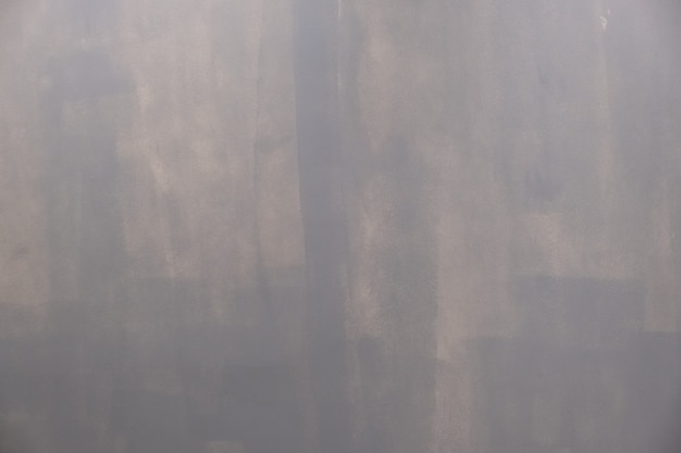 Painted wall by roller grunge background with copy space for text