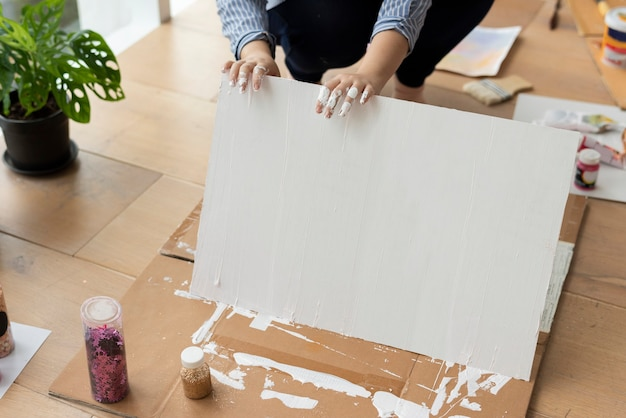 Painted white background on wooden floor