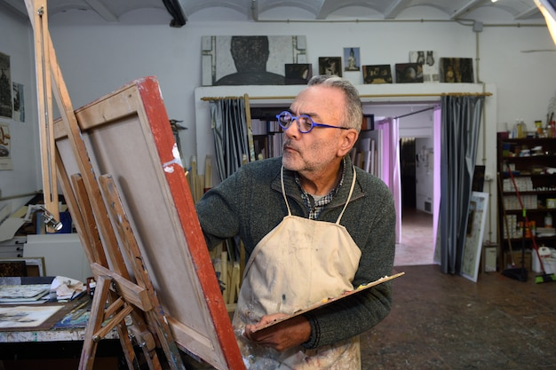 Painter artist painting a picture in the studio