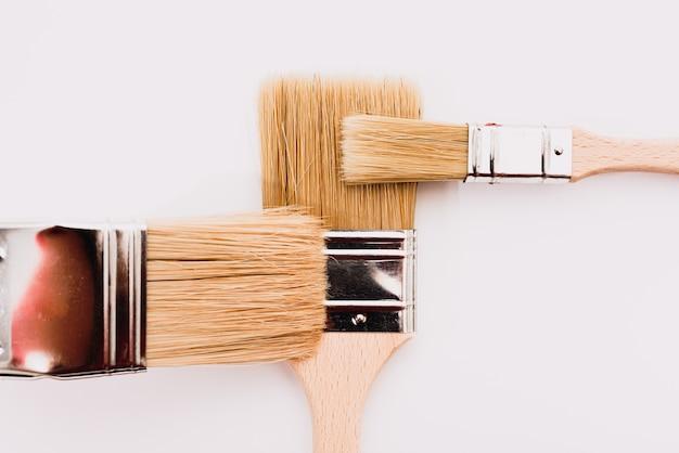 Painter brushes on white, flat lay