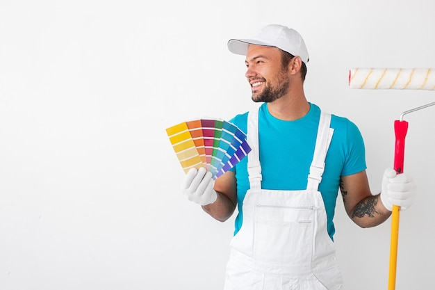 Painter holding colorful palettes