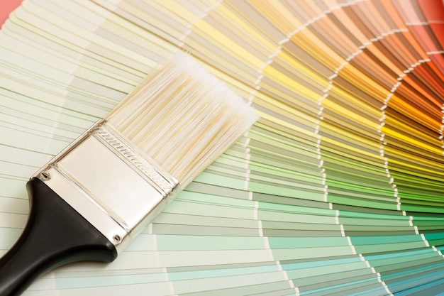 A painter is choosing a paint shade for the interior of the house's walls. with interior