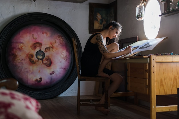 Painter making a drawing in her studio