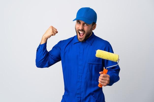 Painter man holding a paint roller