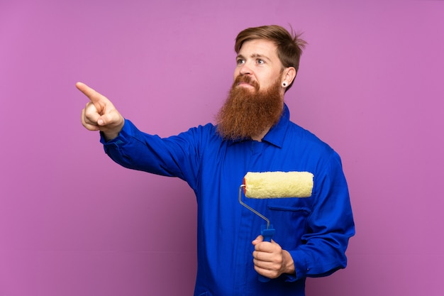 Painter man with long beard touching on transparent screen