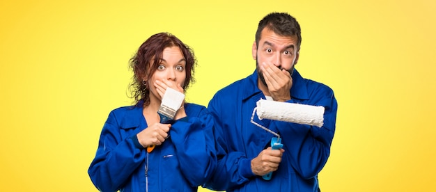 Painters covering mouth for saying something inappropriate.