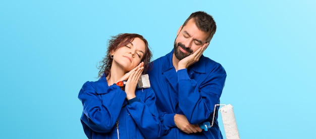 Painters making sleep gesture. adorable sweet expression on colorful background