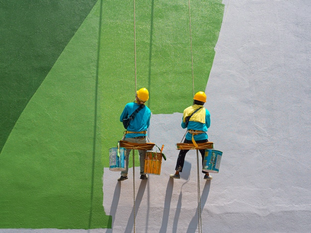 Painters painting exterior of building