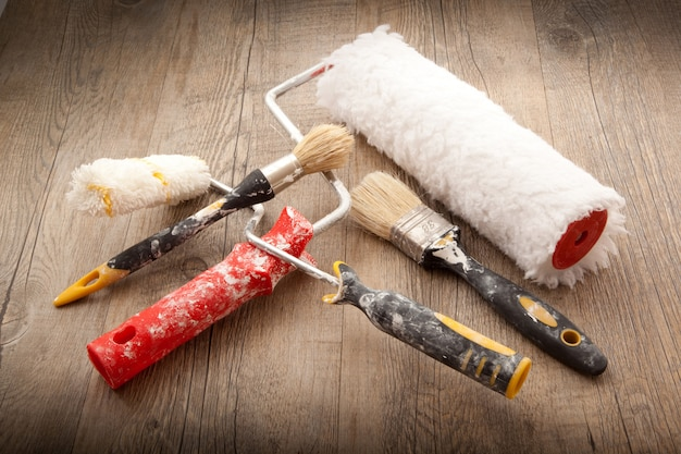 Painters tools in wooden background