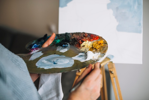 Painting concept with woman holding color palette
