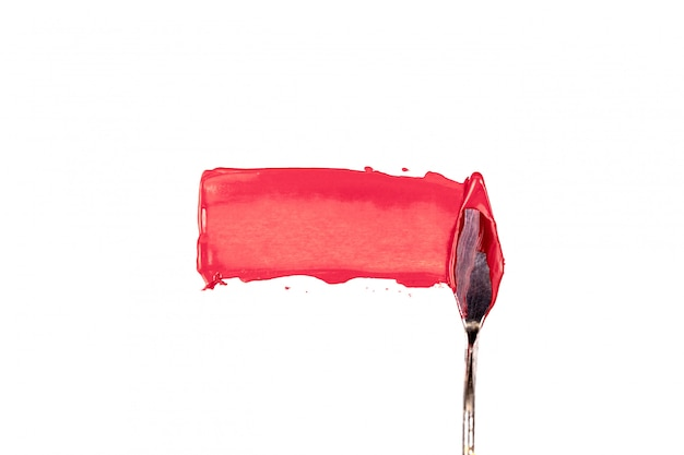 A painting palette knife isolated on a white background painting a red