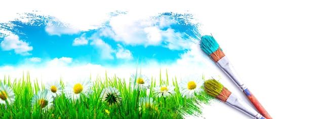 Картина весенний пейзаж. кисть синей краской по небу и зеленому полю.