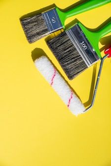 Painting tools. brushes and roller.paint roller and brush in the accessories for home renovation