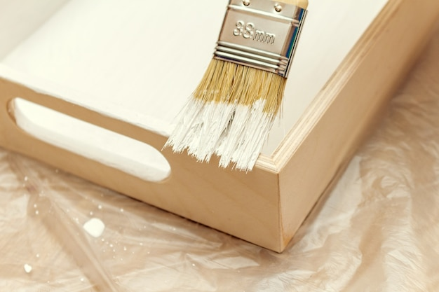 Painting a wooden tray salver with white paint