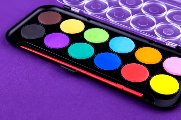 Paints palette isolated on purple