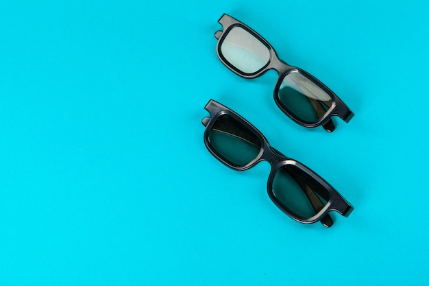 Pair 3d glasses on blue background. flat lay.