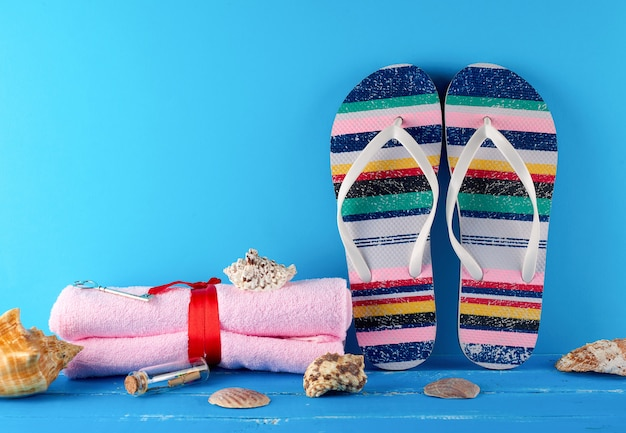Pair of beach slippers and towels