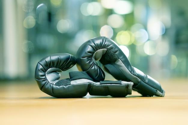 Pair of black box gloves in gym.