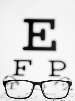 Pair of black framed glasses with a testing blank